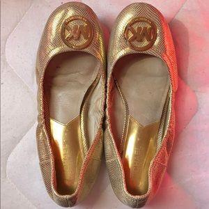 Michael Kors gold flats